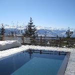 Heated pool next to a pile of snow. Genius!