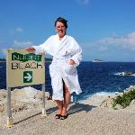 My wife dressed in just a hotel towelling bath-robe at the top of the Naturist area.