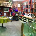 A portion of the gift shop featuring losts of local handicrafts and art.