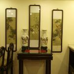 paintings and vases at breakfast area