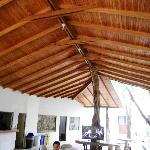 The roof of the Center main building was all natural wood construction with tree trunks for sup