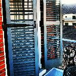 Shuttered french doors from the balcony to the suite