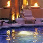 Night pool view with fire pits