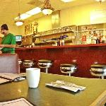 reading the menu over early morning coffee in grandma's diner - charles town, west virginia