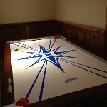 Air hockey in the game room!