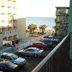 parking lot, with view of the oceanfrom our balcony and a hotel beside of Montego Inn