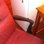 torn arm chair in the Room