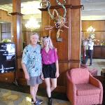 Dad and daughter by the Carnival mask in the Lobby