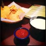 Chips, salsa and a small cheese dip