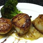 Diver Scallops on bed of caramelized onions and balsamic drizzle