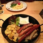 Plate of sausages and plate of Obatzda