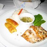 dourade(mahi mahi) with rice snow peas, bananas and sauce