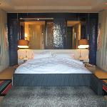 Bed dominates the room