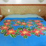 beautiful bed sheet on comfy king-size bed (I bought one)