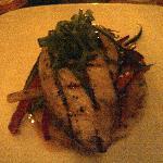 Marlin steak with seasoned veggies on a crab cake base