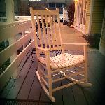 The cute whie rocking chair on the porch