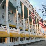 View of the many flags that hang from the porch of The Grand Hotel