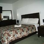 Room 3 has queen bed and a sofa located on second floor shares 1 full bathroom & extra shower w/