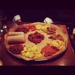 Our meal for two - selection of meat and veg dishes served on Ethiopian bread injera