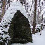 "Bluestone sculpture, ""Birth"" on sculpture trail"