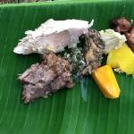 the food slow cooked on volcanic stones, served on banana leaves