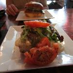 Open face portobello sandwich in front and BBQ pork in back