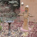 St. Francis carving in a courtyard at the inn