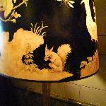 very cool lampshade in lobby area with devlish squirrel