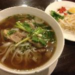 Pho Bo: Home made beef noodle soup served with fresh herbs and spices