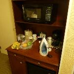 Microwave and fridge under