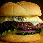 Bleu Cheese burger with bacon, grilled onions, provolone cheese. All our burgers are handmade.
