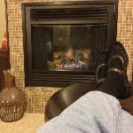 Comfortable seating in front of the fire in the Madison Lakes suite