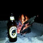 Ice Cold Tusker by the camp fire