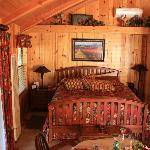 Cozy bed in the Creekside Room