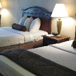 Recently remodeled room with2 double beds with pillowtop mattresses.