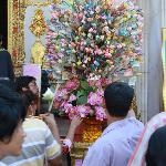 Baht-flower donations at Wat Boworniwet...an active place for the community