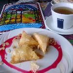Delicious honey and mint tea with baklawas and Jericho's menu.