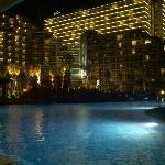 View of the hotel from the pool at night.