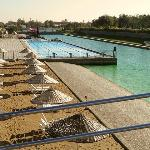 Part of the artificial beach with the outdoor swimming pool