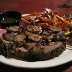 Prime rib with sauteed mushrooms and sweet potato fries.