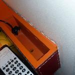 Broken furniture - desk unit loose from wall plaster