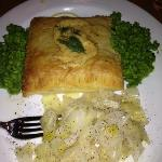 Salmon puff pastry with mushy peas and cabbage