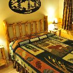 Queen bed with Alaskan quilt