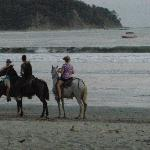 dusk horseback riding on the beach