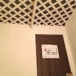 view of the door and lattice ceiling