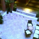 Groups of hotel rooms are placed around a small courtyard