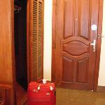 Teak wood wardrobe at room entrance