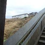 Looking up at motel from 1/2 ways down to the beach on the stairs