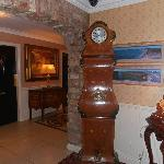 Unusual long-case clock in the foyer