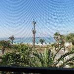 view of transformer and beach from screened in balcony